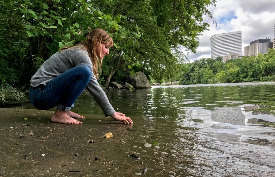 """Clare Kelley practices """"forest bathing"""" along the edge of an urban forest on Roosevelt Island, in the middle of the Potomac River. In contrast to hiking, forest bathing is less directed, melding mindfulness and nature immersion to improve health."""