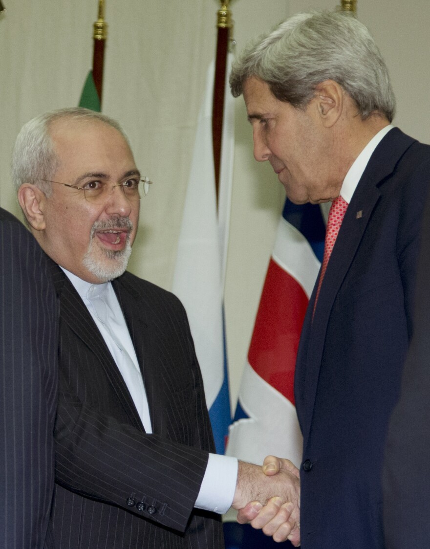 Secretary of State John Kerry and Iranian Foreign Minister Mohammad Javad Zarif shake hands Sunday at the United Nations Palais in Geneva.