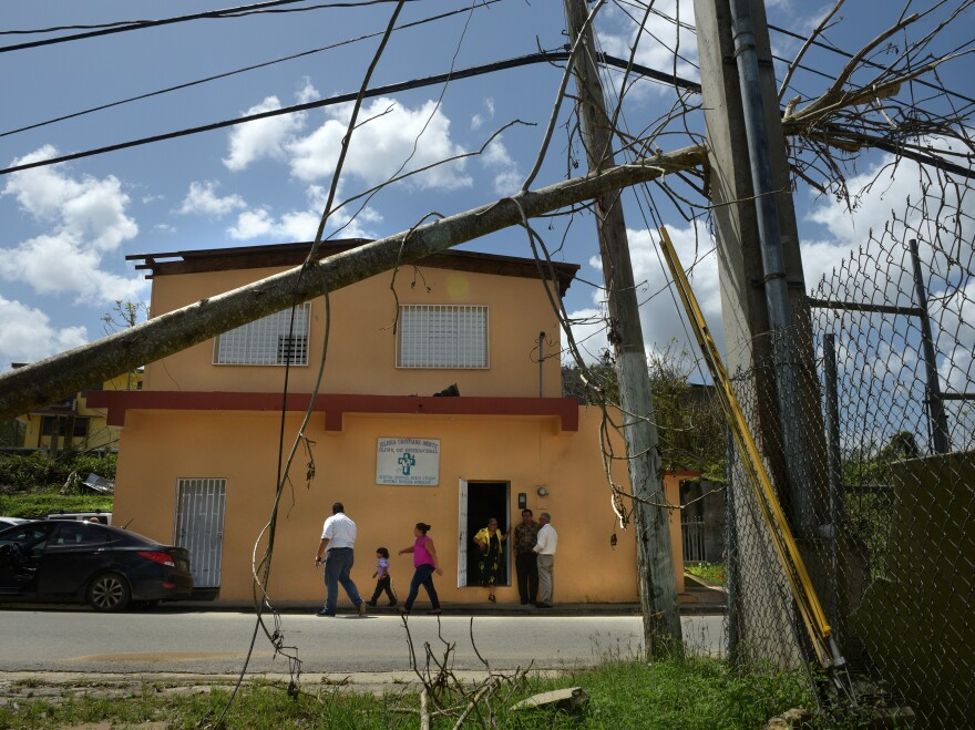 Rubble from Hurricane Maria surrounds the Iglesia Cristiana Monte Olivar church.