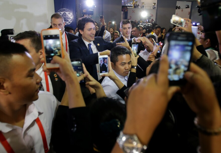 """Trudeau, surrounded by admirers at November's Asia-Pacific Economic Cooperation summit in Manila, the Philippines, was dubbed a """"hottie"""" by the Filipino media."""