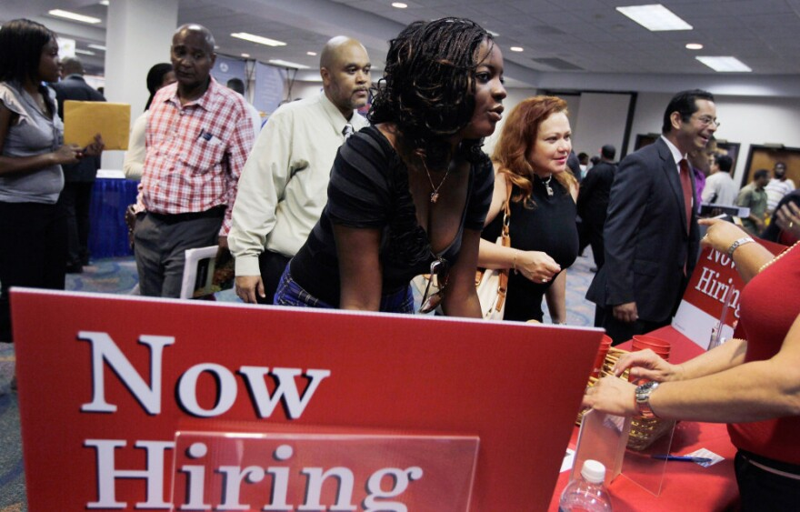 Job seekers met with recruiters during a recent job fair at the James L. Knight Center in Miami.