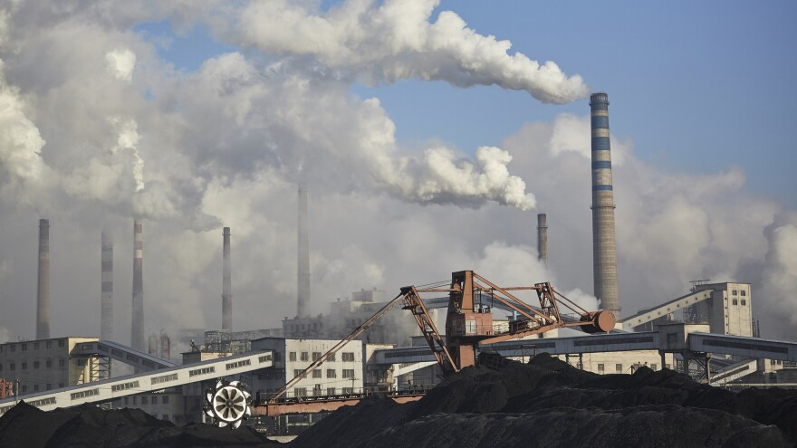 Thick clouds emanate from a coal-burning power plant in Baishan, in the Jilin province of China. In an effort to boost its economy, China has recently started greenlighting coal projects that had been on hold.