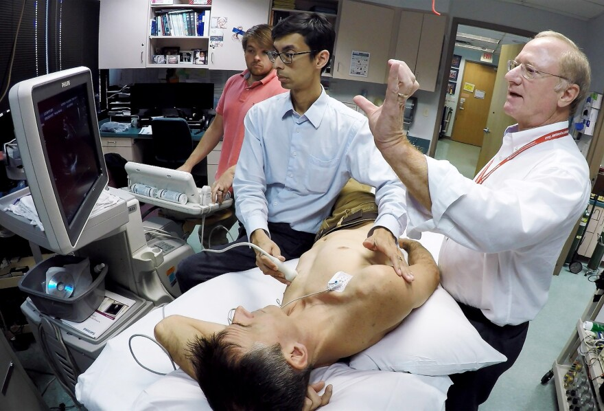 Dr. Benjamin Levine performs an echocardiogram on Ben Lecomte to record a baseline of his heart function at the Institute for Exercise and Environmental Medicine in Dallas.