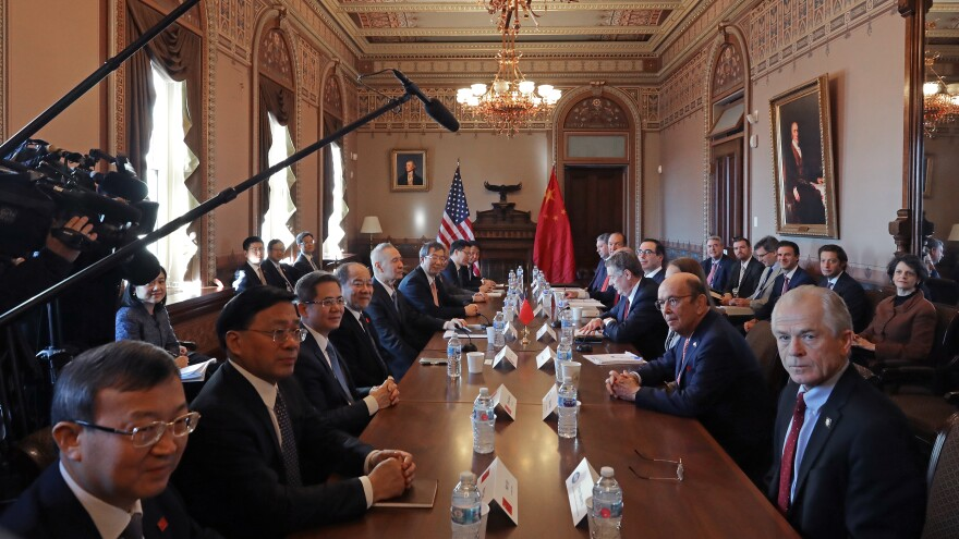 Navarro, Commerce Secretary Wilbur Ross, U.S. Trade Representative Robert Lighthizer, Treasury Secretary Steven Mnuchin and other Trump administration officials sit down with Chinese senior officials for trade negotiations at the Eisenhower Executive Office Building on Jan. 30, 2019.