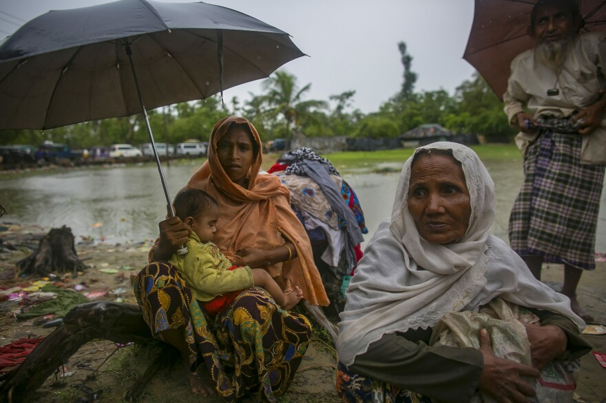 Rohingya refugees arrive in Bangladesh on Sunday. They are fleeing government violence in Myanmar.