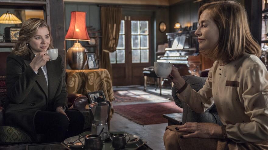 Frances (Chloë Grace Moretz) and Greta (Isabelle Huppert) spill the tea in Neil Jordan's <em>Greta</em>.