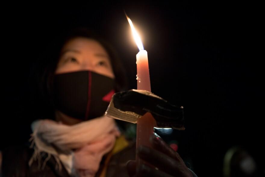 Saori Ishida holds a candle during a vigil for Ruth Bader Ginsburg.