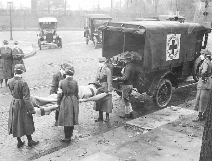Red Cross workers tend to St. Louis pandemic victims in 1918. (Added May 21, 2020)
