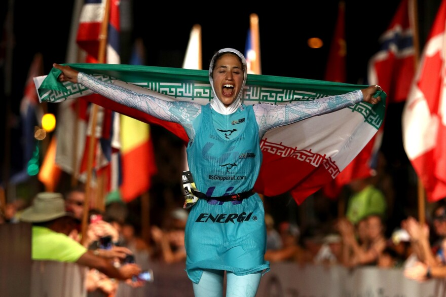 Shirin Gerami celebrates after finishing the 2016 Ironman triathlon in Kona, Hawaii.