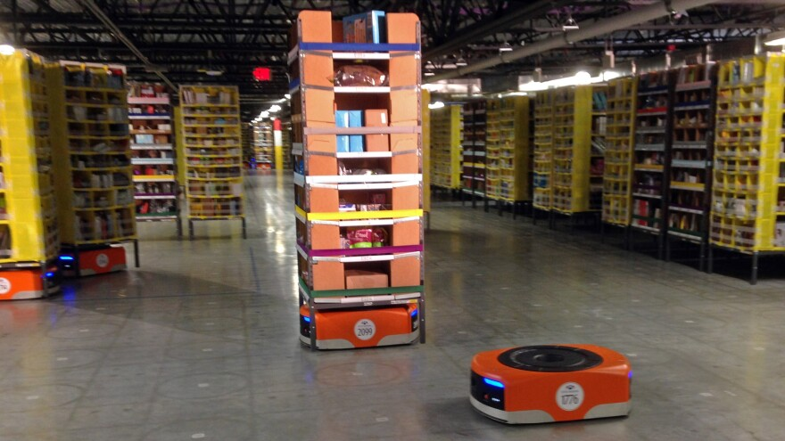 Kiva robots maneuver around one of Amazon's newest distribution centers on Sunday in Tracy, Calif.