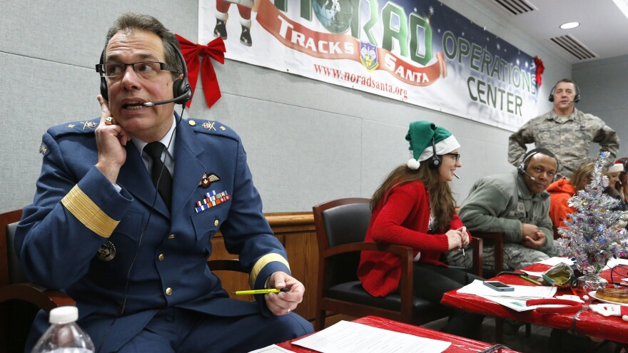 Every year, NORAD staff and volunteers field calls from children inquiring about Santa. Canadian Brig. Gen Guy Hamel joined in the tradition in 2014.