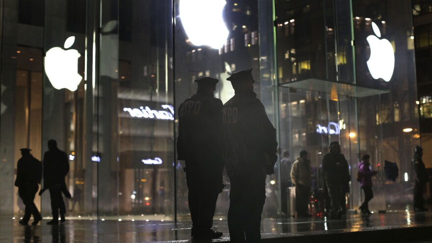 New York police officers monitor a pro-encryption demonstration at an Apple store in February.