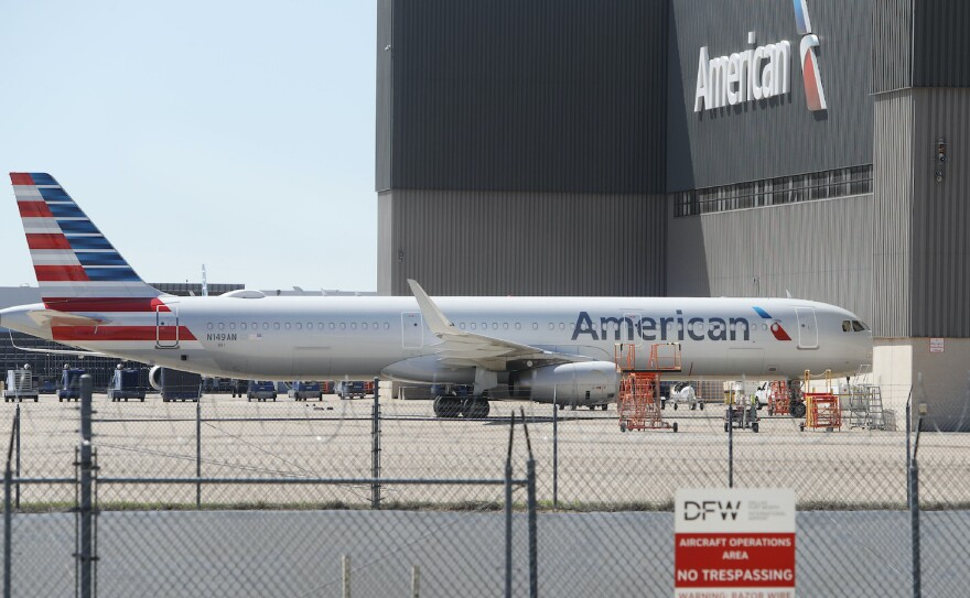 An American Airlines plane sits parked at the Dallas/Fort Worth International Airport in Grapevine, Texas, on March 25, 2020.