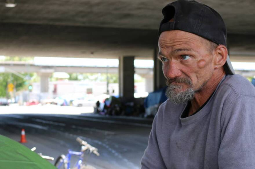 "Jeffrey Hill's tent burned down in an encampment fire in late May 2017. The cause of the fire is not known. Hill calls his encampment at Fifth and Brush streets a ""family,"" but also says it has become harder to maintain order as the encampment has grown in size. (Devin Katayama/KQED)"