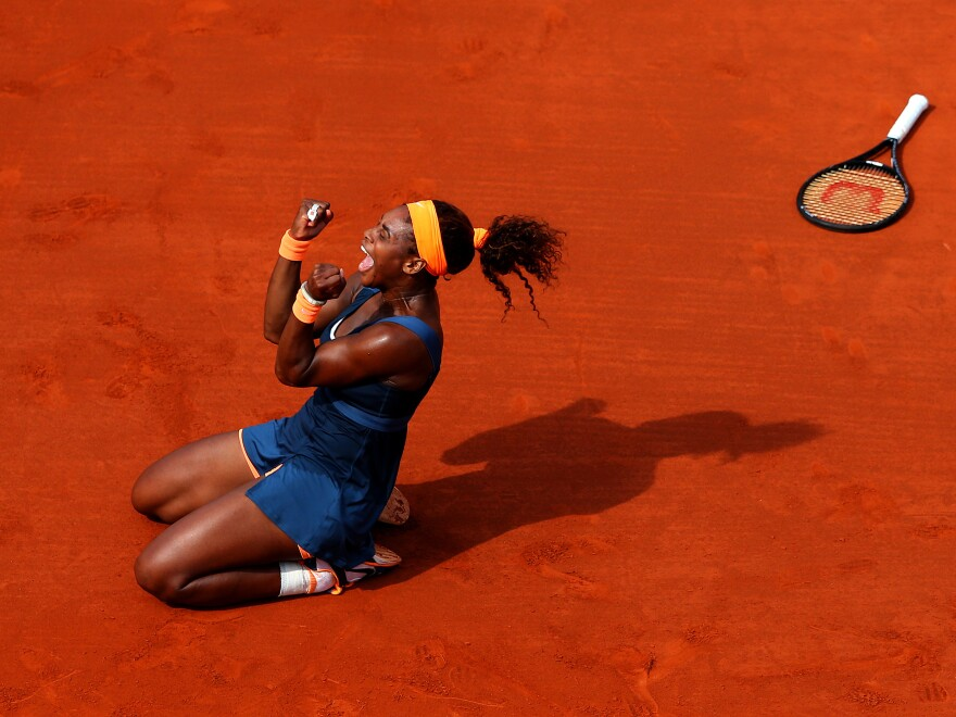 Serena Williams celebrates match point Saturday against Russian Maria Sharapova at Roland Garros in Paris.