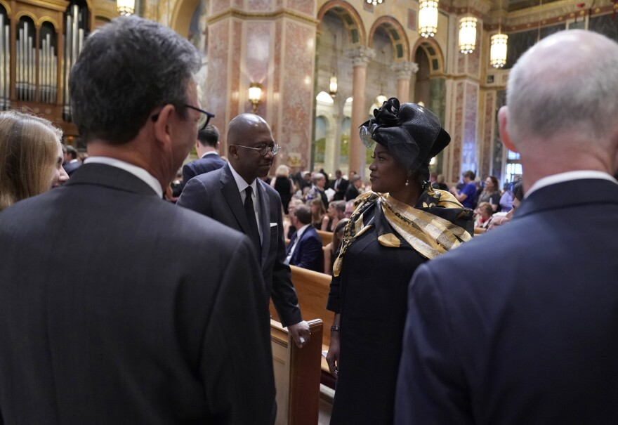 Pierre Thomas, left and Donna Brazile talk at Cokie Roberts' funeral.