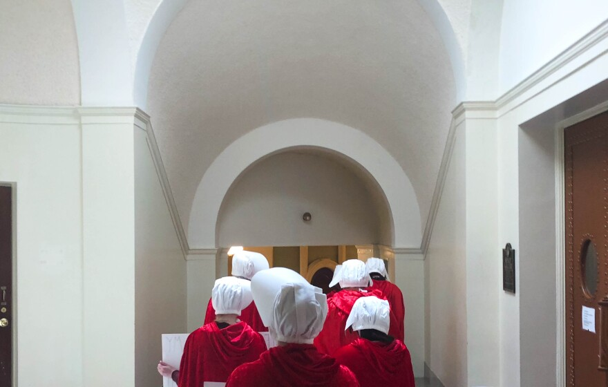 """Advocates for reproductive rights visit the Missouri Capitol on Thursday dressed as characters from Hulu series """"The Handmaid's Tale."""" May 10, 2018"""
