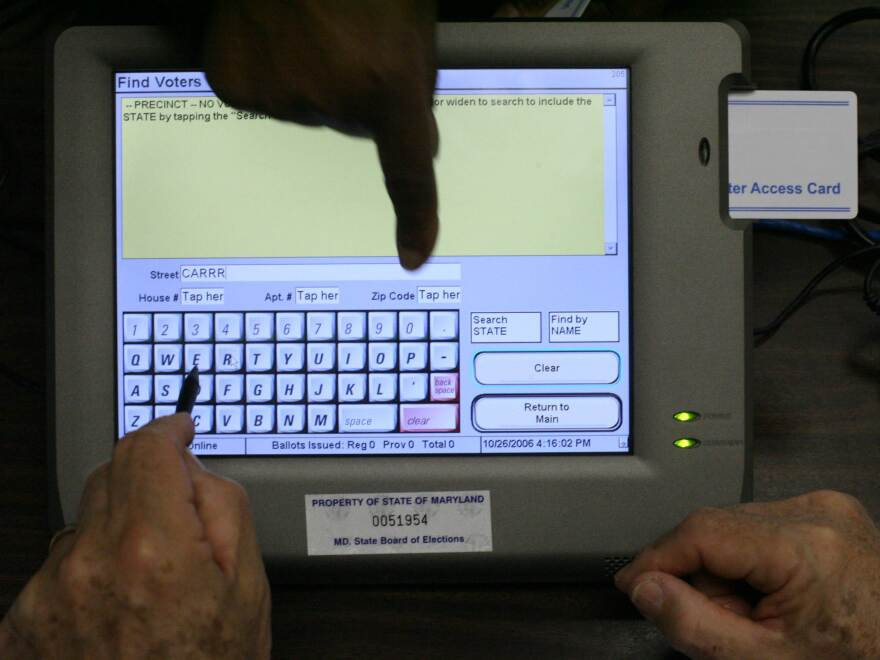 A touchscreen electronic poll book in Montgomery County, Md., being used for training in 2006. The technology has sped up voting lines but also raises potential security issues. The Durham, N.C., electronic poll books that failed were laptop-based.