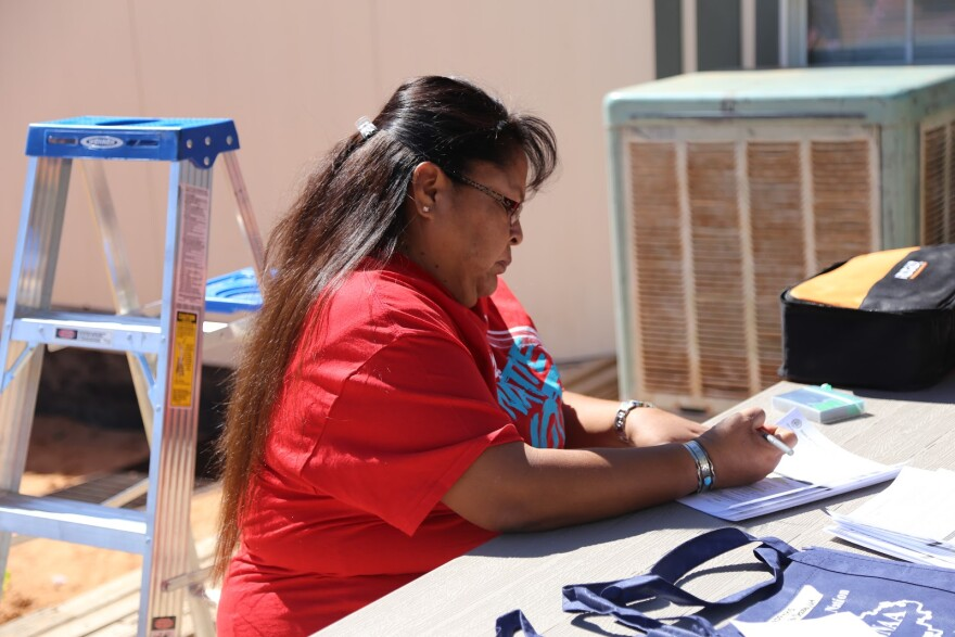 Photo of Navajo woman filling out form.