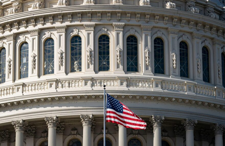 The American flag flies at the U.S. Capitol in Washington, DC.