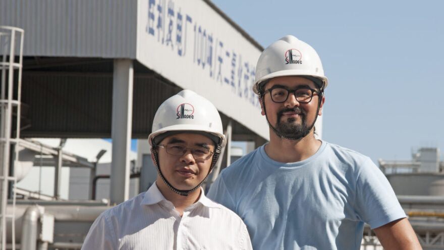 Akshat Rathi (R) on a tour of Sinopec's Shengli Dongying coal power plant. In the background, the plant's carbon capture unit.