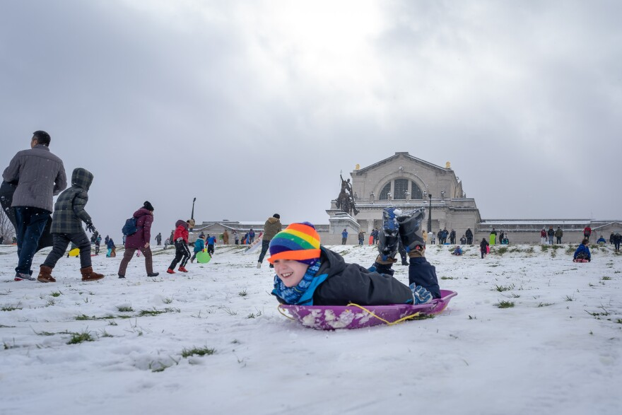 A boy goes head first down Art Hill on Thursday. He and hundreds of others enjoy a rare November snow storm by sledding in Forest Park. Nov. 15, 2018