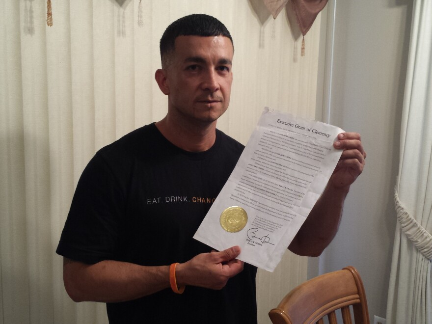 """Jason Hernandez holds the piece of paper that changed his life --€"""" the letter from President Obama commuting his sentence."""
