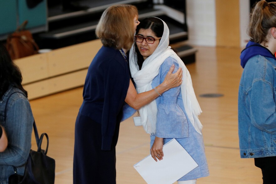 Malala Yousafzai is congratulated after collecting her A-level exam results at Edgbaston High School for Girls in Birmingham, England.