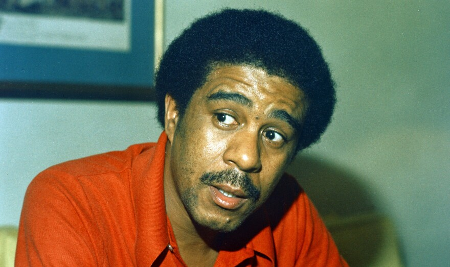 """Comedian Richard Pryor, pictured in 1977, grew up in a brothel, surrounded by violence. """"He said once that it's easier for him to talk about his life in front of 2,000 people than it is to do it one on one,"""" says Scott Saul, whose new book is <em>Becoming Richard Pryor</em>."""