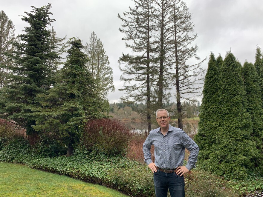 Epik CEO Rob Monster standing in the backyard of his home in Sammamish, Wash.