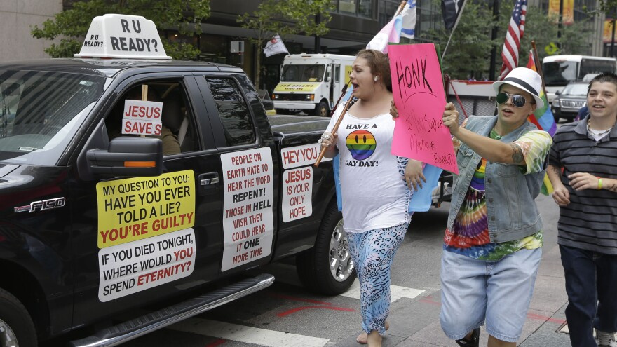 Gay-marriage supporters follow an opponent of same-sex marriage in August, when four courts argued to preserve their bans on the unions in a federal court in Cincinnati. The court confirmed the states' bans.
