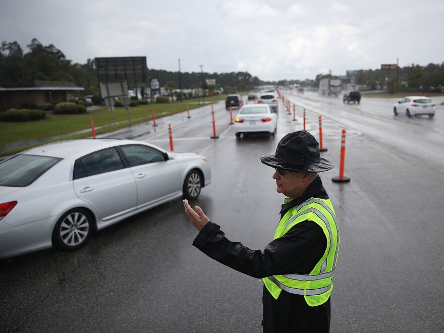 Vehicles were directed onto U.S. 501 in Myrtle Beach, S.C., Tuesday. The state government ordered traffic to use all the lanes on the route leading away from the coast to facilitate evacuations ahead of Hurricane Florence.