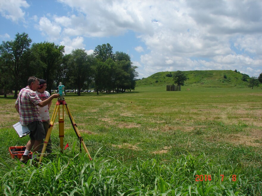 Washington University archaeologist John Kelly works with a student mapping research at Cahokia Mounds.