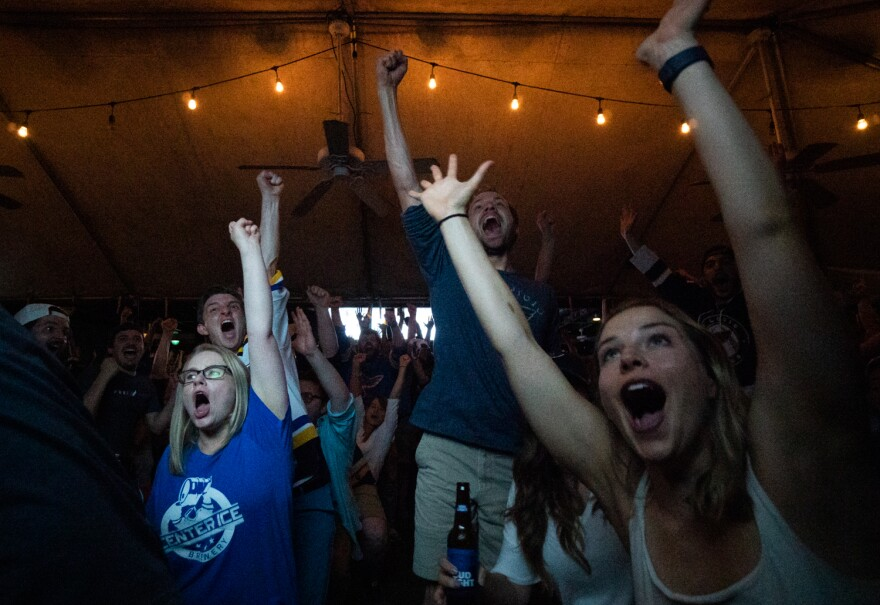 Emily Wendt (right), 27, of Shrewsbury and fellow St. Louis Blues fans celebrate a goal during Game 5 of the Stanley Cup Final at the Amersterdam Tavern in south St. Louis. June 5, 2019