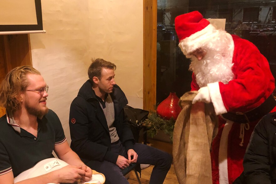 An applicant performs in a test-run as Santa at a workspace rented by Tholey's agency in Berlin, Germany.