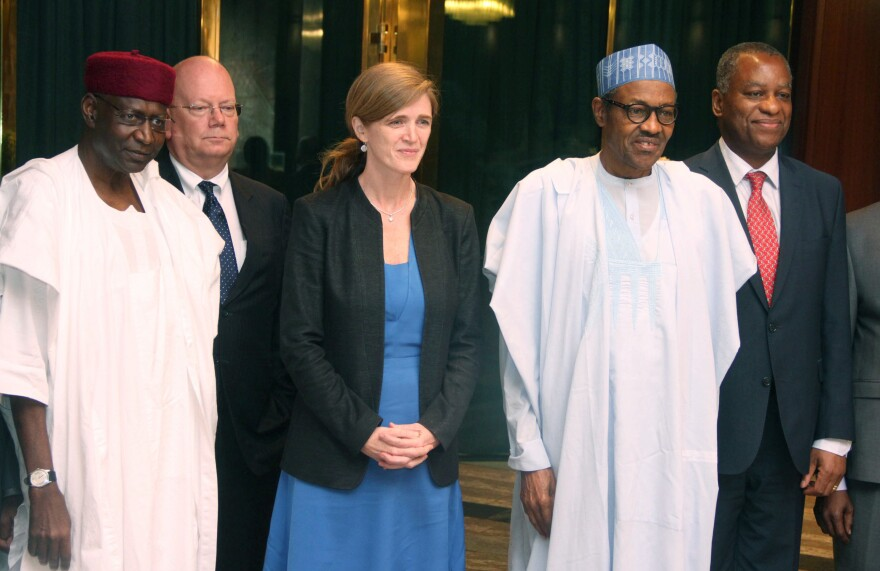 Abba Kyari (L) poses in a group photo with Nigerian President Mohammadu Buhari (second from right) in 2016.