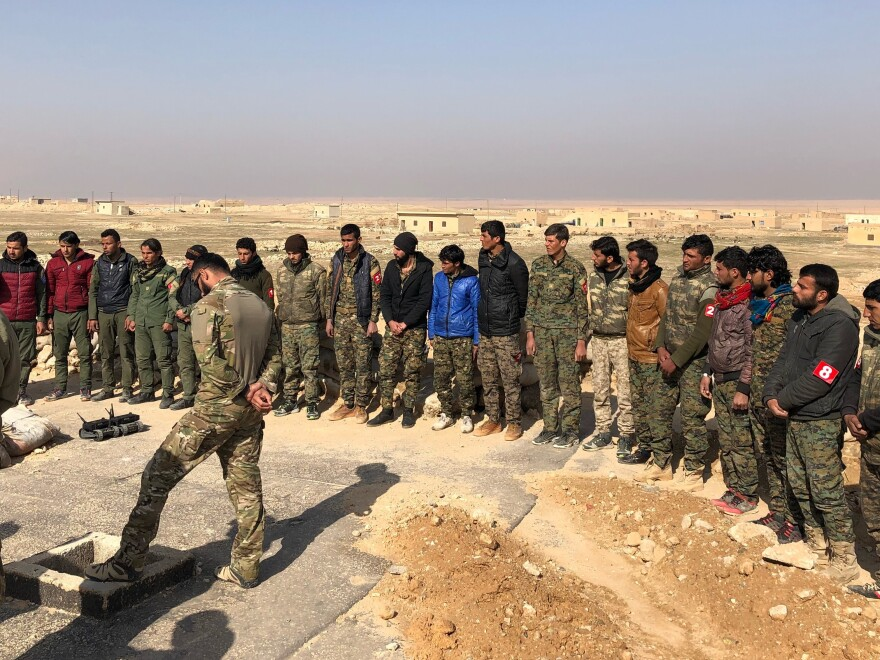 Young men outside Raqqa, Syria, training to find and destroy hidden explosive devices left by retreating ISIS forces.