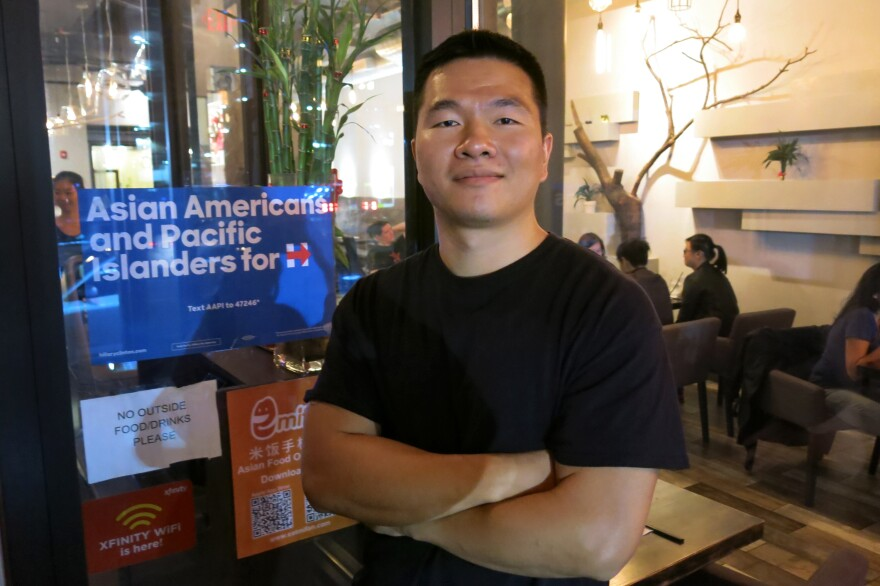 """Xu Lin co-owns Bubblefish, a restaurant in Philadelphia's Chinatown neighborhood. His support for Hillary Clinton is based more on his dislike of Donald Trump, whom he labels as a """"racist, xenophobic, homophobic, sexist"""" person."""