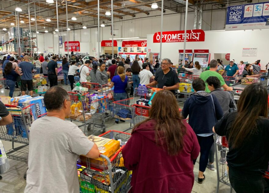 Shoppers buy toilet paper, food and water at a store, as people begin to panic buy and stockpile essentials from fear that supplies will be affected by the spread of the COVID-19, coronavirus outbreak across the country, in Los Angeles, California.