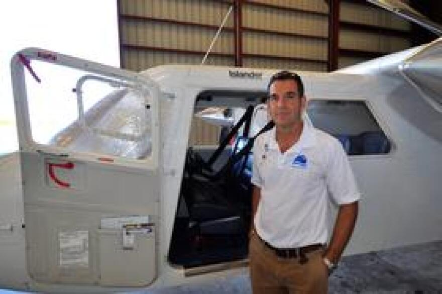 Air Key West owner and pilot Rob Valle stands in front of his Britten-Norman Islander. The 10-seat plane flies weekly from Key West to Havana and back on Fridays.