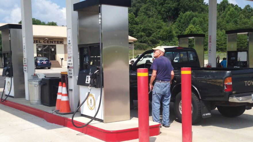 Bob Thomas fills up his pickup truck at the municipal-run gas station in Somerset, Ky. There are no candy bars, 44-ounce soft drinks or lottery tickets sold. The price of gas here is $3.36 a gallon, about 20 cents lower than the statewide average.