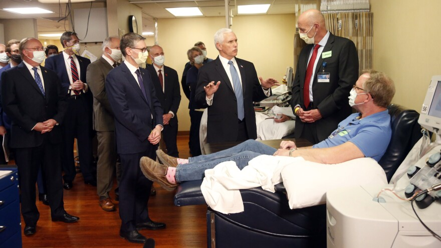 Vice President Pence visits with coronavirus survivor Dennis Nelson at the Mayo Clinic in Rochester, Minn., during a tour of facilities supporting COVID-19 research and treatment.