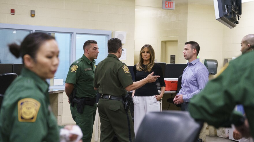 First lady Melania Trump talks with Border Patrol agents as she visits a processing center of a U.S. Customs and Border Protection facility in Tucson, Ariz. Thursday.