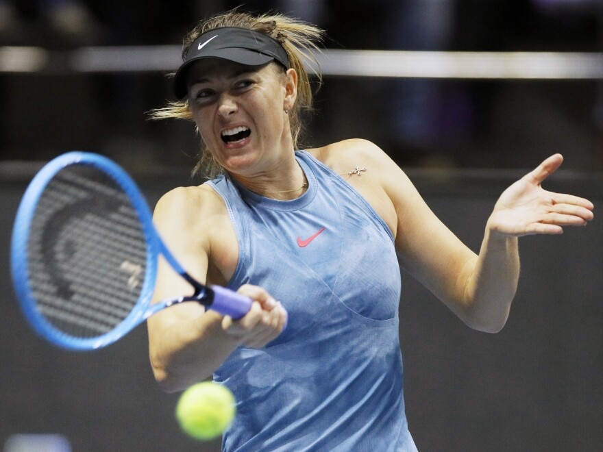 Maria Sharapova, of Russia, returns the ball to Daria Gavrilova, of Australia, during the 2019 St. Petersburg Ladies Trophy tennis tournament match in St. Petersburg, Russia.