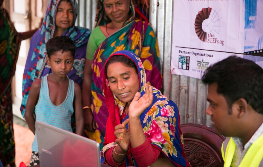 A patient consults with a doctor during a Teledaktar session on a char near Rangpur, Bangladesh. The visit is an opportunity for the patients, especially women, to air their concerns about aging, motherhood and reproductive health.