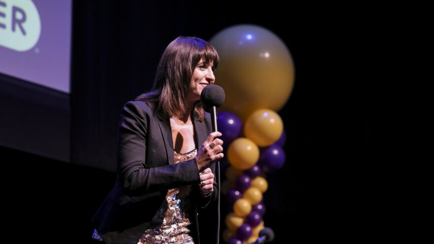Ophira Eisenberg performs on stage on <em>Ask Me Another</em> at the Lobero Theatre in Santa Barbara, California.