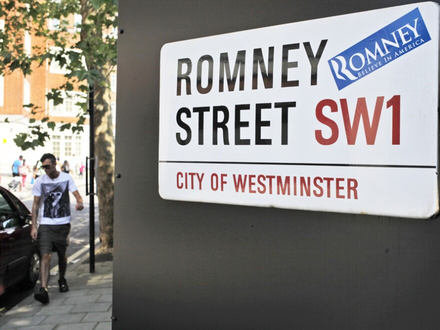 A campaign sticker for Republican presidential candidate Mitt Romney is seen on a sign for Romney Street in London on Wednesday, as Romney arrived to meet with leaders, hold fundraisers and attend the opening of the Olympics.