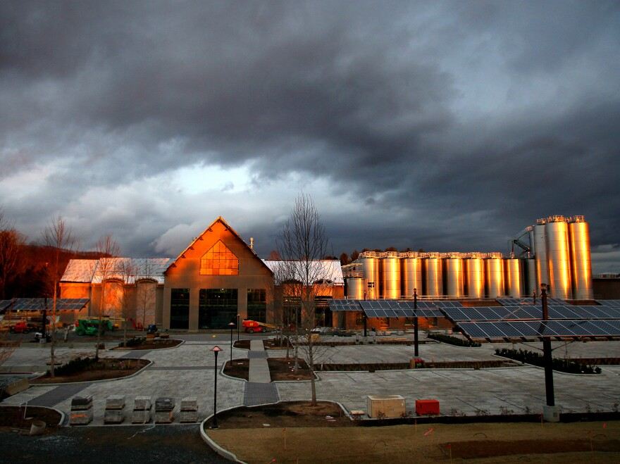 Sierra Nevada's brewery in Mills River, N.C., aglow in early morning light in December 2013. The company was attracted to the Asheville area because it offers access to good water for brewing and the outdoors for employee recreation.