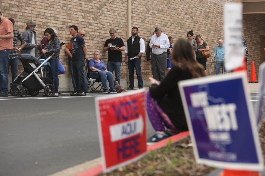 A line of voters waits to cast ballots on Election Day.