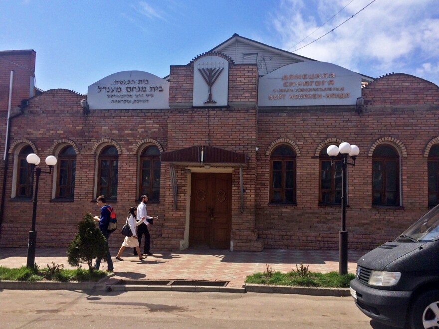After evening prayers at this synagogue in Donetsk, Ukraine, earlier this week, a group of masked men in camouflage distributed a stack of leaflets that instructed local Jews to come to occupied buildings to register or face expulsion.